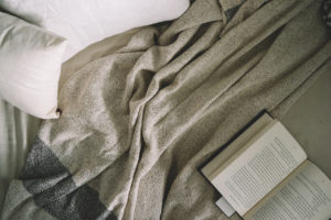 Reading a book is a great way to fall asleep. Turn off those electronics!